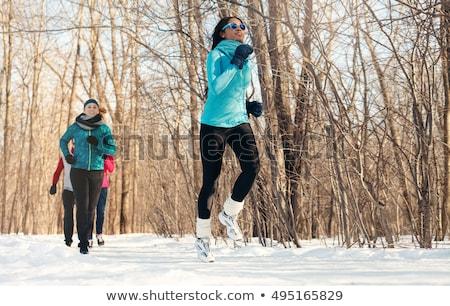 Groep vrienden genieten jogging sneeuw winter Stockfoto © Lopolo