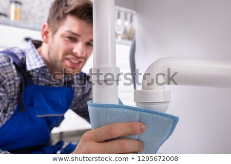 Plumber Holding Napkin To Stop Sink Pipe Leakage Stock photo © AndreyPopov
