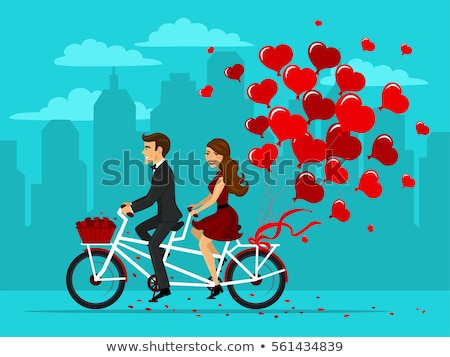 Man and Woman Riding on Bike with Red Balloon Stock photo © robuart