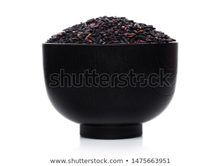 Black bowl of raw organic black venus rice on white background. Healthy food.  Stock photo © DenisMArt