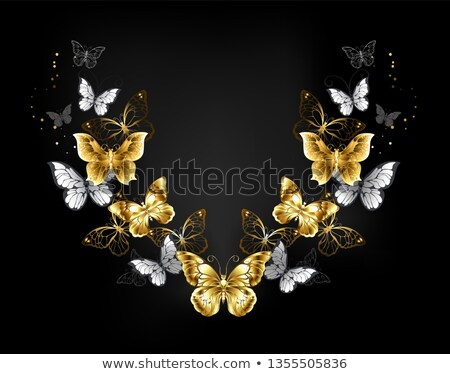 Symmetrical pattern of gold and white butterflies Stock photo © blackmoon979