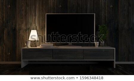 modern tv set with empty blank screen on the wooden cabinet stock photo © boggy
