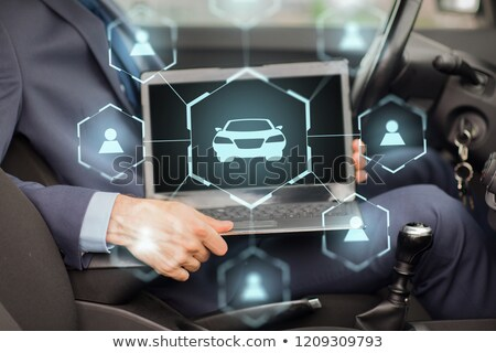 businessman with laptop and car sharing icons Stock photo © dolgachov