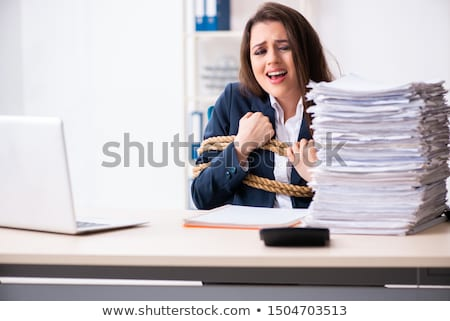 Young beautiful employee tied up with rope in the office  Stock photo © Elnur