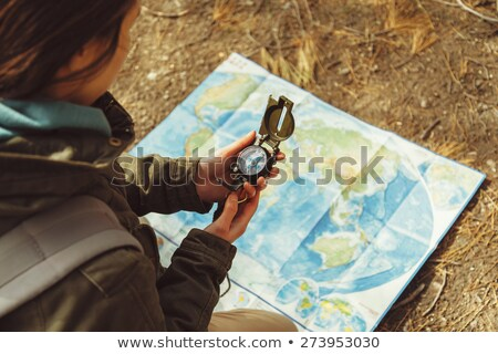 Hiker searching direction with a compass in the forest.  Stock photo © ijeab