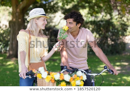 Multiracial couple with bicycle standing in the autumn park Stock photo © boggy