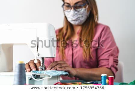 Woman doing tailoring work Stock photo © Kzenon