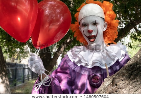 scary clown behind a fence Stock photo © nito