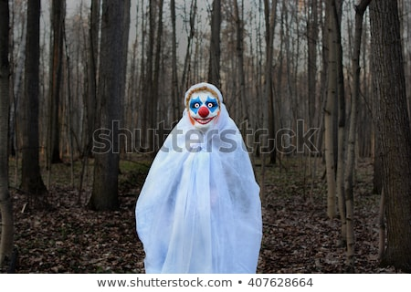 scary clown standing outdoors Stock photo © nito