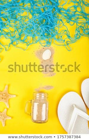 Notebook schelpen glas zand witte top Stockfoto © Illia