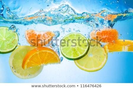 Exotic orange fruit under water Stock photo © nomadsoul1