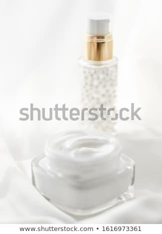 Face cream moisturizer jar and serum gel on white silk, skin car Stock photo © Anneleven