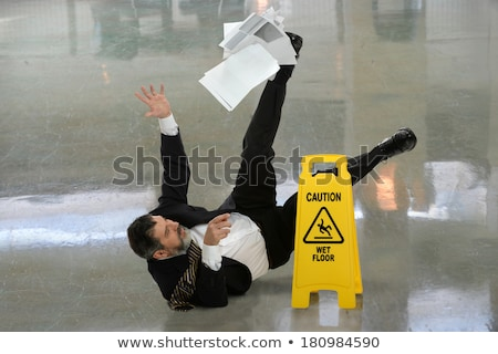 Człowiek objętych mokro piętrze ostrożność podpisania Zdjęcia stock © AndreyPopov