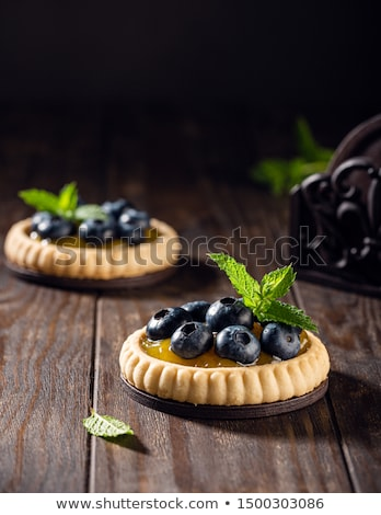 Tartlet filled with lime curd and blueberries Stock photo © Melnyk