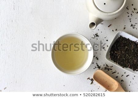 Teáskanál zöld tea tele fából készült háttér zöld Stock fotó © AlphaBaby