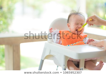 little asian baby girl crying on a high chair stock photo © kenishirotie