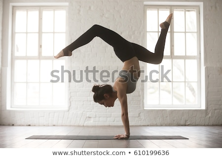 Attractive Woman Standing in Yoga Pose Stock photo © rognar