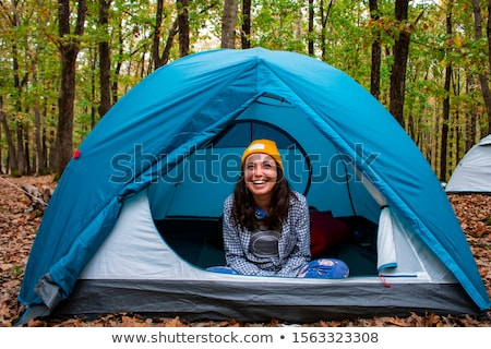 Stock photo: teenager in a tent