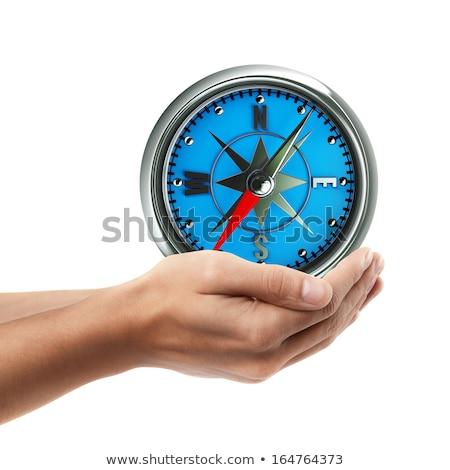 Man's Hand Holding Compass Isolated on White Background Stock photo © Qingwa