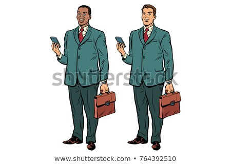 African Businessman Holding Two Telephones Stock fotó © studiostoks