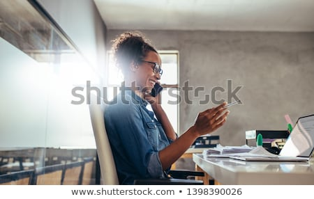 Business professional talking on the phone Stock photo © photography33