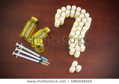 vaccination vials on wooden background Stock photo © inxti