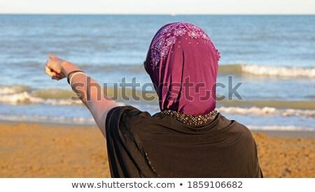 Girl indicating to the horizon Stock photo © broker