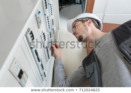 Electrician Installs Wiring in Wall stock photo © lisafx