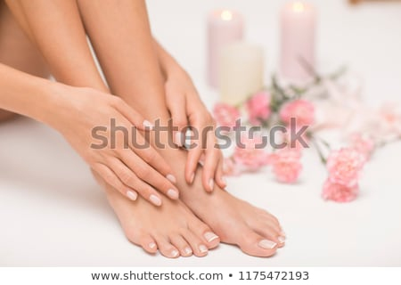 Stock photo: Feet and hand