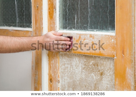 Tradesman smoothing a plank of wood Stock photo © photography33