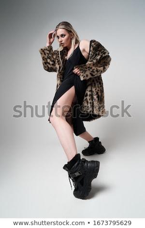 Lány visel kabát fekete macskanadrág izolált Stock fotó © acidgrey