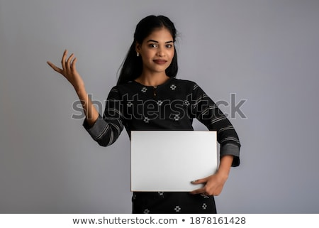 Asian businesswoman pointing to a signboard Stock photo © stryjek