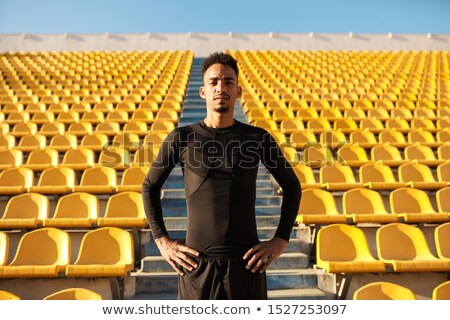 Good-looking male sprinter training in a stadium Stock photo © wavebreak_media
