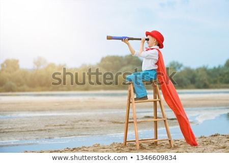 Oldalnézet fiú tart távcső gyermek háttér Stock fotó © zzve