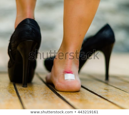 Sticky bandage on woman heel Stock photo © AndreyPopov