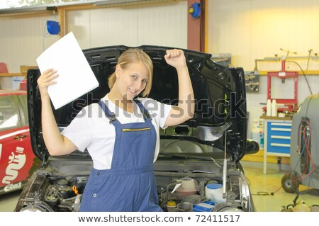 Female car mechanic has passed the exam and is happy. Stock photo © runzelkorn