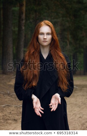 Beautiful redhead girl in the forest Stock photo © Nejron