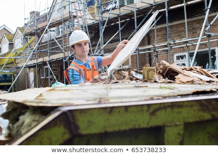 builder putting waste into rubbish skip stock photo © highwaystarz