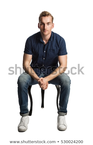 Sad man in blue shirt sitting and looking down  Stock photo © feedough