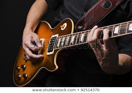 lezser · gitáros · tart · gitár · arc · fehér - stock fotó © feelphotoart