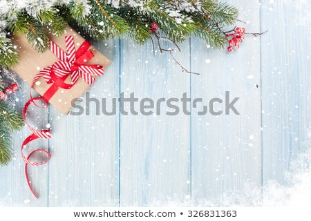 Stock photo: blue fir tree with gift box