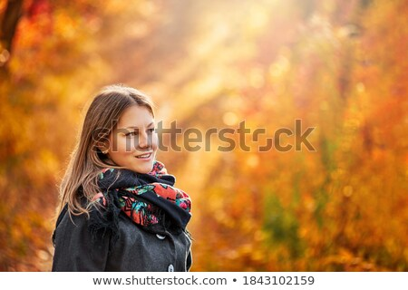 woman with a cup of hot tea posing outdoors Stock photo © Nobilior