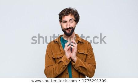 Csintalan fickó hideg jóképű férfi visel Stock fotó © phakimata
