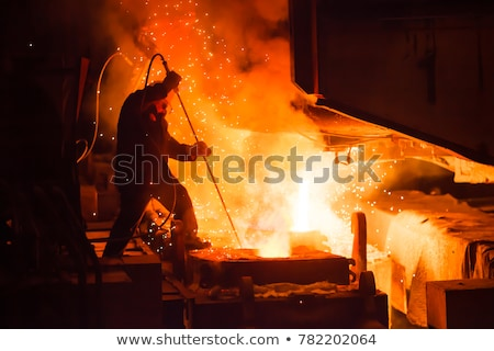 hot steel pouring stock photo © mady70