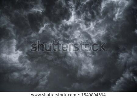 dramatik · fırtınalı · gökyüzü · karanlık · bulutlar · yağmur - stok fotoğraf © dariazu
