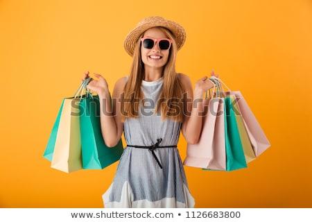 vásárlás · jókedv · lezser · fiatal · lány · hordoz · bevásárlószatyor - stock fotó © neonshot