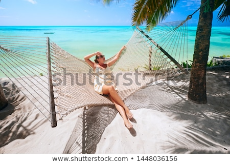Beautiful young woman relaxing near the sea stock photo © artfotoss