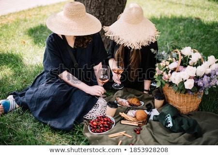 Genç güzel bir kadın çim tok bahar çiçekleri bağbozumu Stok fotoğraf © photocreo