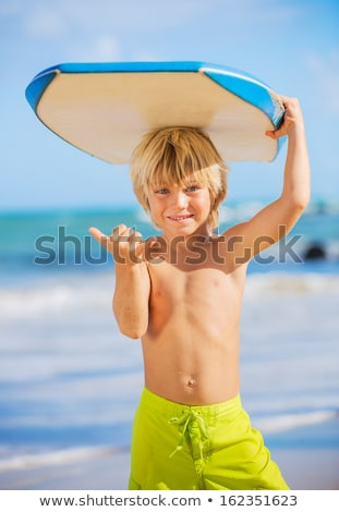 Young Surfer Boy Stock photo © jeayesy
