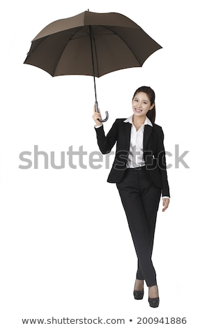 portrait of a smiling asian businesswoman standing with legs crossed stock photo © deandrobot